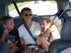 Jean and kids in van